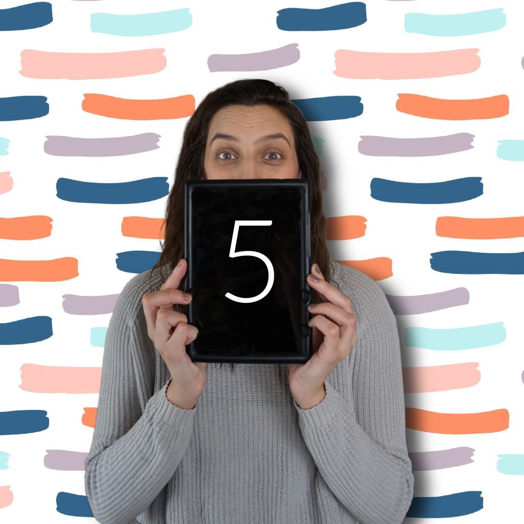 a photo of sarah holidng up a tablet with the number 5 on it